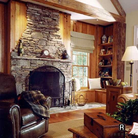 stone indoor fireplace in family den firerock building