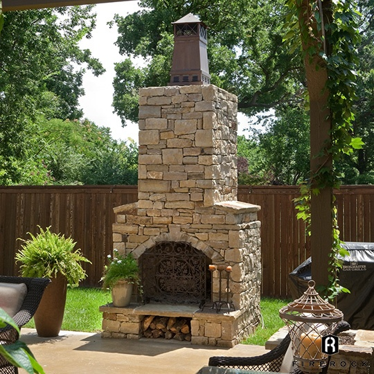 Knight Chimney Cap on Outdoor stone Fireplace