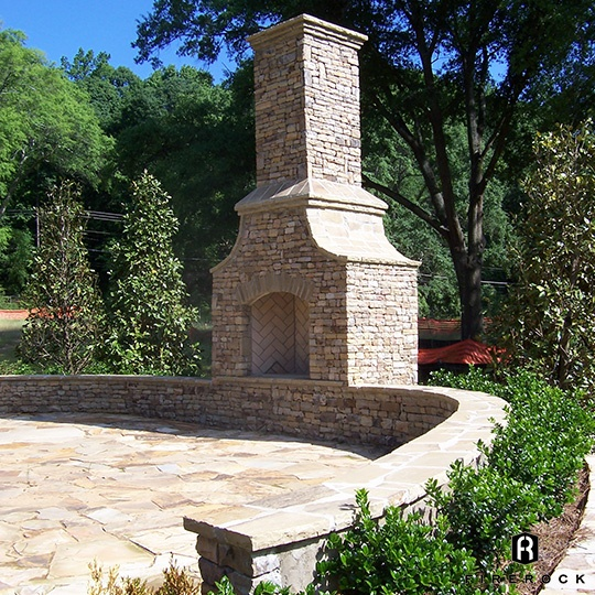 Curved Patio Wall with Herringbone Fireplace